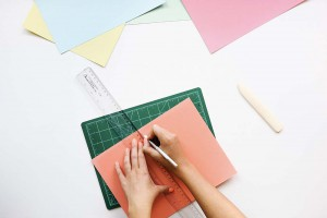 Picture of envelopes and a hands holiding a ruler.